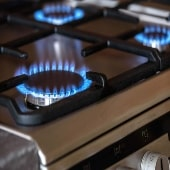 Image of gas hob with blue flame
